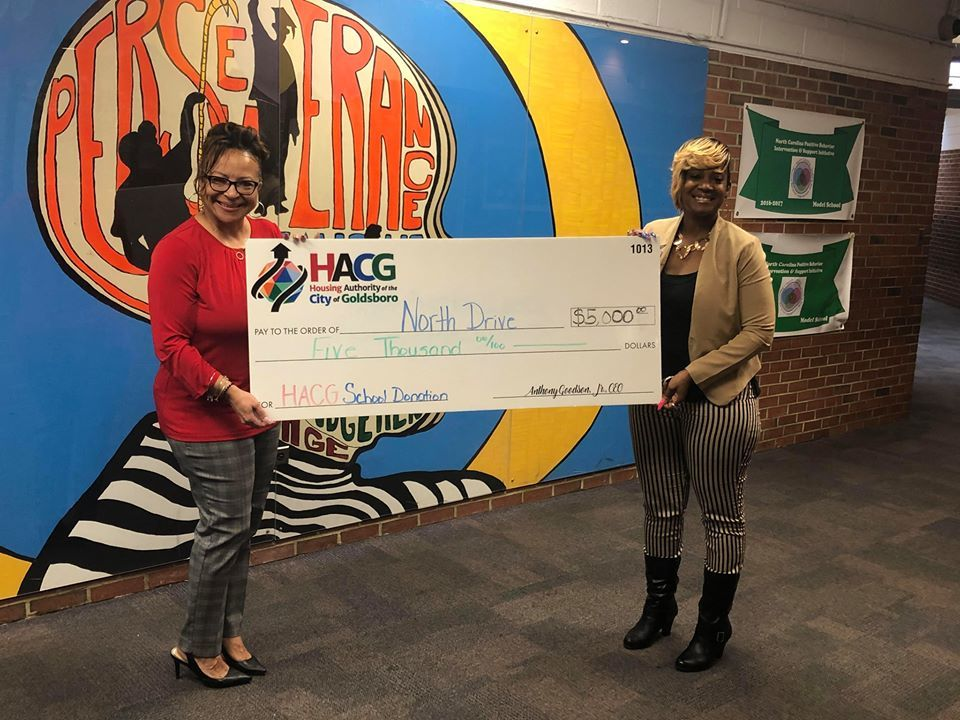 HACG with North Drive Principal presenting monetary donation