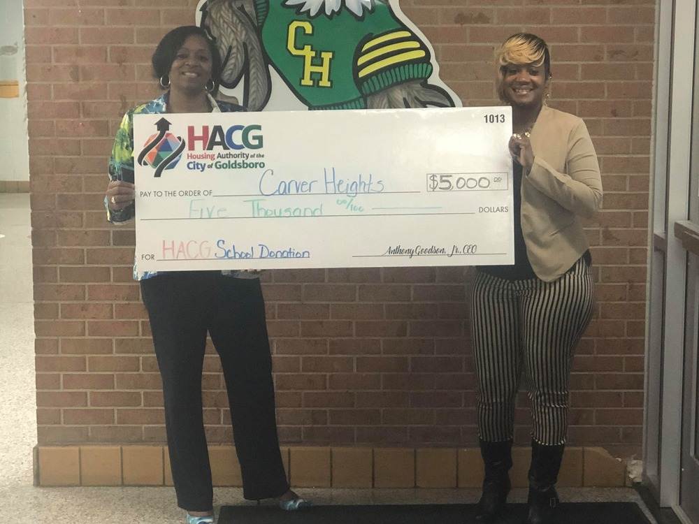 HACG with Carver Heights Elementary principal presenting donation