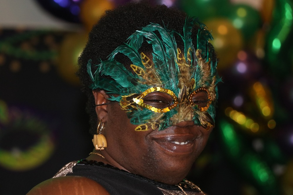 female with mardi gras mask on face